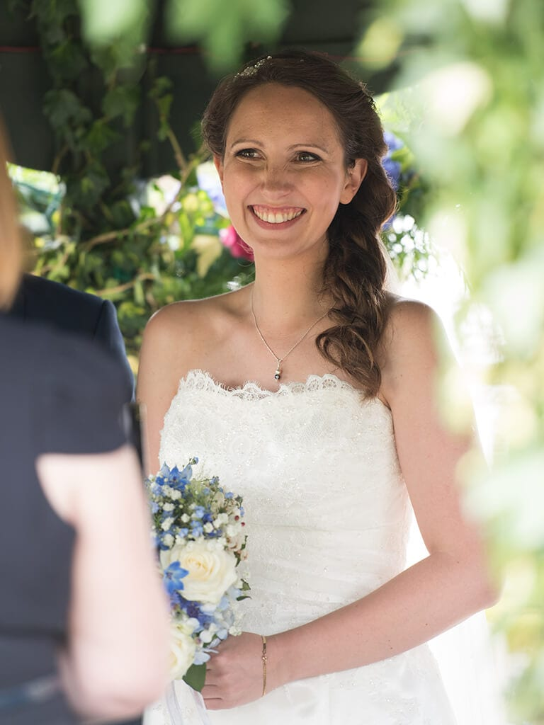 Beautiful bride during her ceremony at the Secret Garden in Kent.